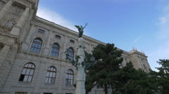Statue of an angel with laurel wreath in front of Art Museum, Vienna Stock Footage