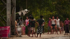Children playing a ball game at train station slow motion - Myanmar Stock Footage