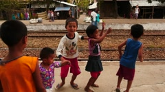 Lucky Myanmar children jumping and dancing - slow motion - stock footage