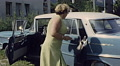 Austria 1966: woman leavin with her car Footage
