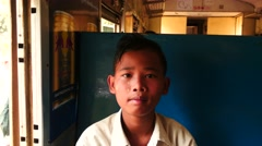 Portrait of Burmese boy sitting in passenger train Stock Footage