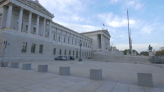 Cars parked in front of the Austrian Parliament Building, Vienna Stock Footage