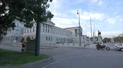Walking and driving in Schmerlingplatz near the Parliament Building, Vienna Stock Footage