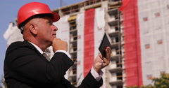 Building Industry Investor Verify Using Touch Tablet Business Investment Level Stock Footage