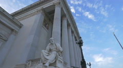Close up of a statue and the columns at Austrian Parliament Building, Vienna Stock Footage