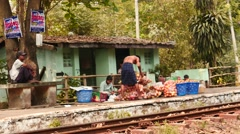Food sellers in railway station near Yangon in Myanmar Stock Footage