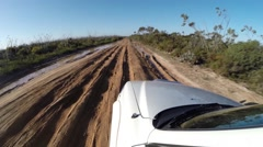 POV 4x4 driving on mud track with deep ruts Stock Footage