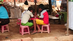 Children eat the food in street cafe - Yangon, Myanmar Stock Footage