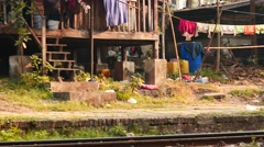 Living houses at railway station in Yangon, Myanmar dolly shot Stock Footage