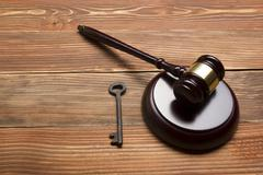 Judges Auctioneer Gavel, Retro Door Key On The Wood Table. Concept For Trial - stock photo