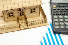 Model house, construction plan for house building, calculator. Real Estate Kuvituskuvat