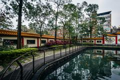 Small pond at a park in the Datong District, in Taipei, Taiwan. Stock Photos