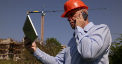 Building Industry Site Manager Cell Talk Team Worker Verify Tablet Project Plans Stock Footage