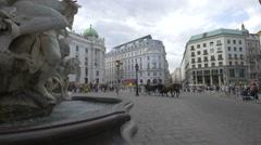 Tourists and locals walking in Michaelerplatz, Vienna Stock Footage