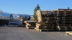 Stacks of wooden shipping pallets. Stock Footage