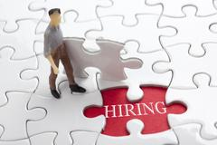 HIRING concept.  Missing Piece Jigsaw Puzzle with word - stock photo