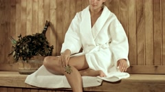 Beautiful young woman relaxing in a wooden sauna Stock Footage