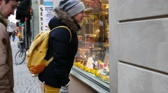 Tourists couple see in window shopping in Stockholm, Sweden, UHD Stock Footage