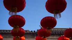Red lanterns hanging in Hutong, celebrating spring fesitval Stock Footage