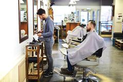 Barber at work - stock photo