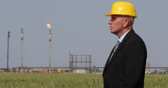 Industrial Petroleum Serious Businessman Looking Around Oil Processing Factory Stock Footage