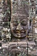 Giant stone face at Bayon Temple in Cambodia Stock Photos