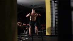 Fitness battling ropes at gym workout fitness exercise Stock Footage