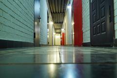 Dark corridor in doors, floors and ceilings in the loft style - stock photo