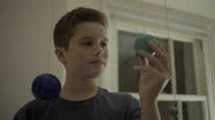 Teenager boy playing with globes in bedroom Stock Footage