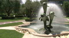 A fountain with three statues of dolphins Stock Footage