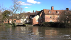 Flatford England historic 17 century mill along river 4K Stock Footage