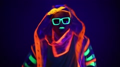 Guy dancing in neon costume Stock Footage