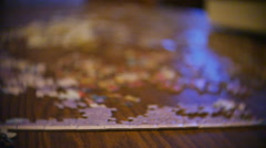 Flying Over Puzzle on Kitchen Table Slow Motion - stock footage