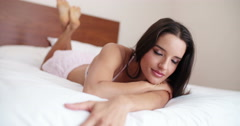 Lady with feet up in the air lying in bed Stock Footage