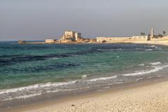 Harbour and crusader fortress archeological excavation ancient city of Caesarea - stock photo