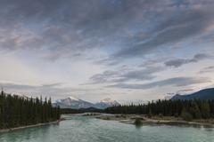 Mount Hardisty and Mount Kerkeslin with Athabasca River View of the Icefields - stock photo