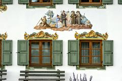 Lueftlmalerei mural with rural scene on the town hall of Wallgau Werdenfels - stock photo