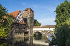 Old halftimbered house and water tower by the river Pegnitz Nuremberg Middle - stock photo