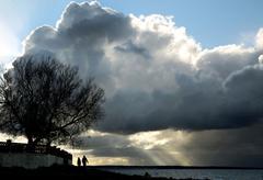 Majorca, blue sky darkened by dark clouds, silhouette Stock Photos