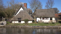 Flatford England historic 17th centrury mill on river 4K Stock Footage