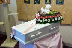 Coffin for a kid Stock Photos