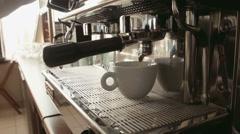 Barista prepares espresso in a coffee machine Stock Footage