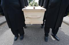 Bearers with coffin - stock photo