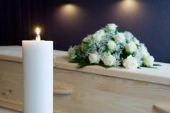 Burning candle in mortuary - stock photo