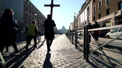 Intense pilgrims march follow the crucifix to saint peter Stock Footage