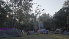 People have rest near the tent at campsite - stock footage