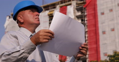 New Building Site Apartments Owner Check Paper Plans Verifying Working Stages Stock Footage