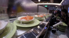 4k, Sushi on conveyor belt in Japan Restaurant, also known as sushi train -Dan Stock Footage