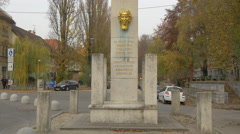 Gilded head statue of Illyria on a monument in Ljubljana - stock footage