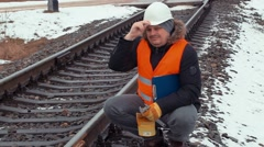 Railroad worker with gloves and helmet on railway Stock Footage